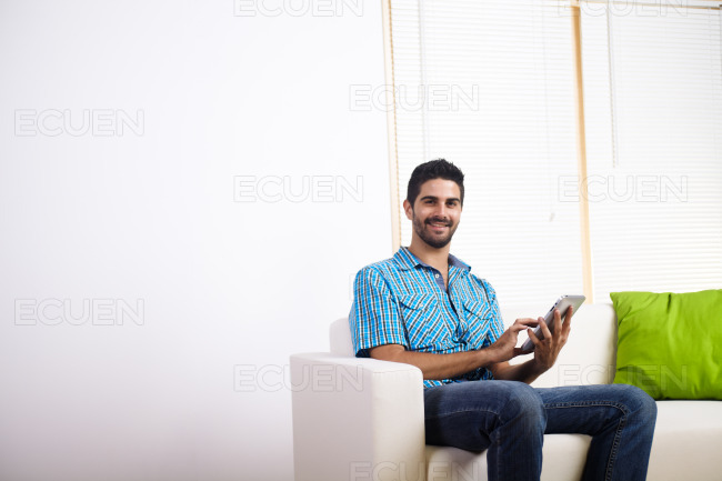Young man using a Tablet PC stock photo