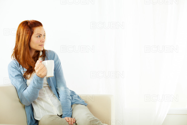 Young woman drinking and resting stock photo