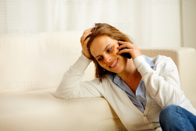 Young woman enjoying conversation on mobile phone stock photo