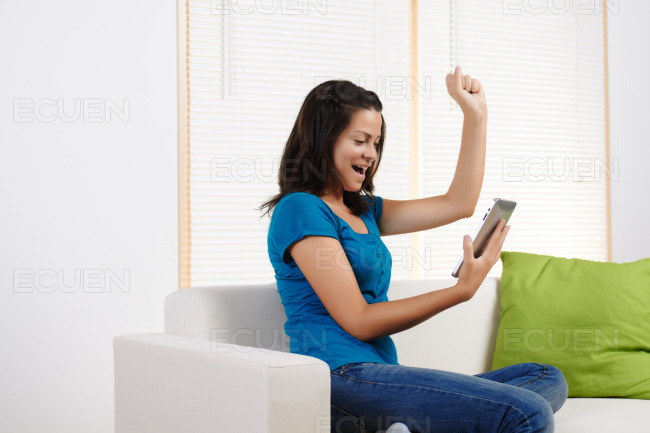 Young woman happy using a tablet PC stock photo