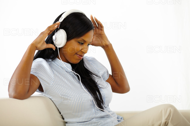 Young woman listening to music and having fun stock photo