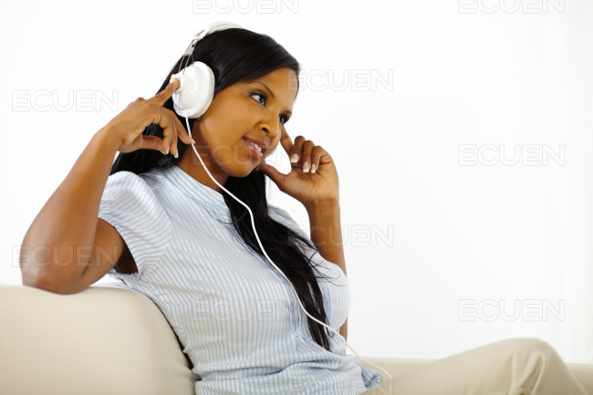 Young woman listening to music and resting stock photo