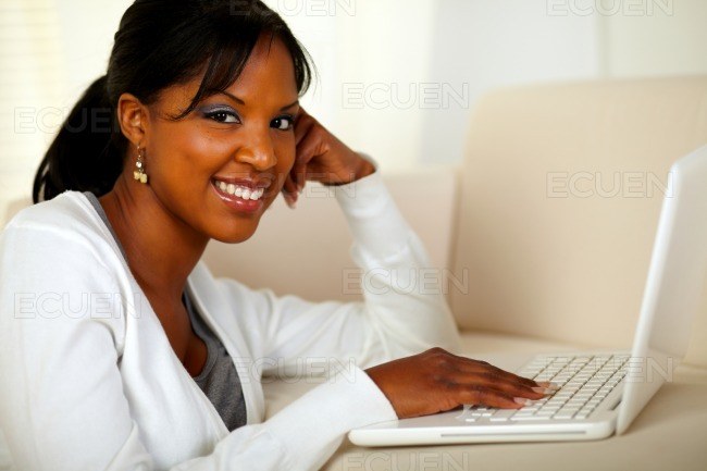 Young woman looking at you browsing the Internet stock photo