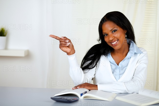 Young woman pointing to his right stock photo