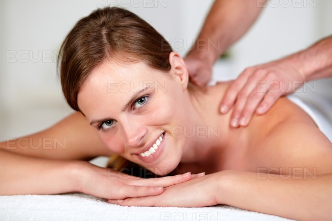 Young woman receiving a body massage at a spa stock photo