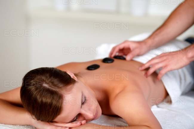 Young woman relaxing at a day spa stock photo