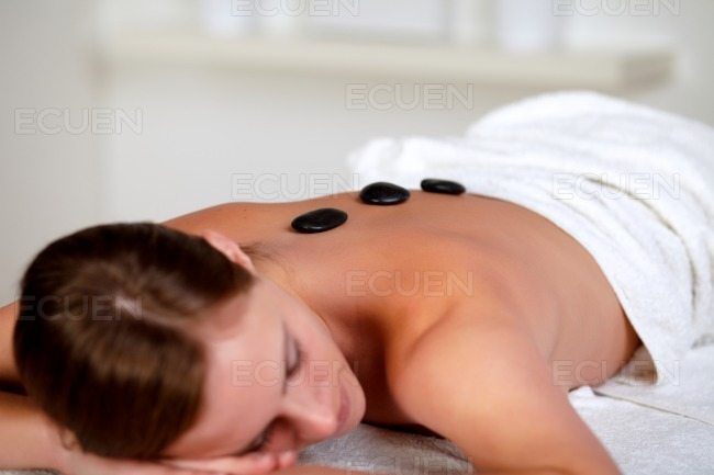 Young woman relaxing face down stock photo
