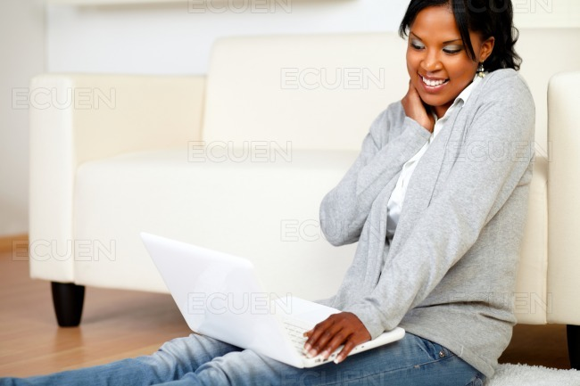 Young woman smiling and browsing the Internet stock photo