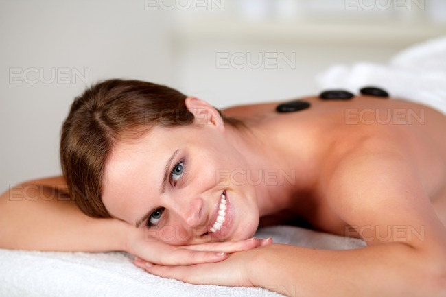 Young woman smiling and relaxing at spa stock photo