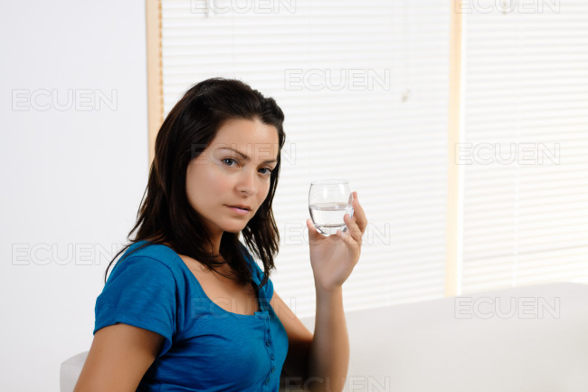 Young woman smiling with glass stock photo