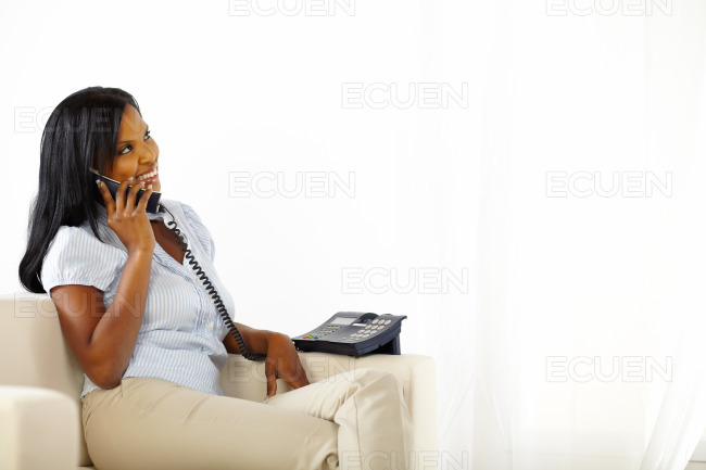 Young woman talking at phone stock photo