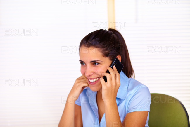 Young woman using a mobile stock photo