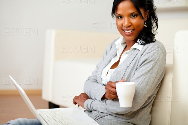 Young woman with a mug looking to you stock photo