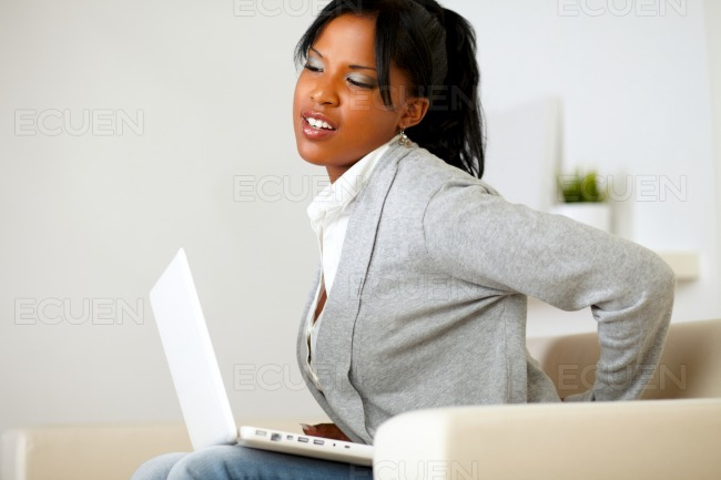 Young woman with back pain stock photo