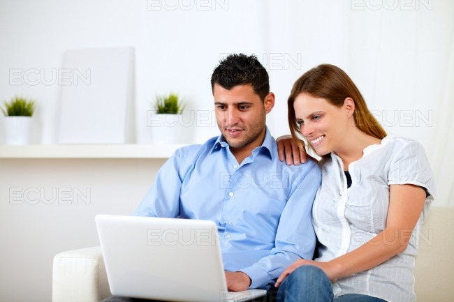 Young woman with her boyfriend chatting stock photo