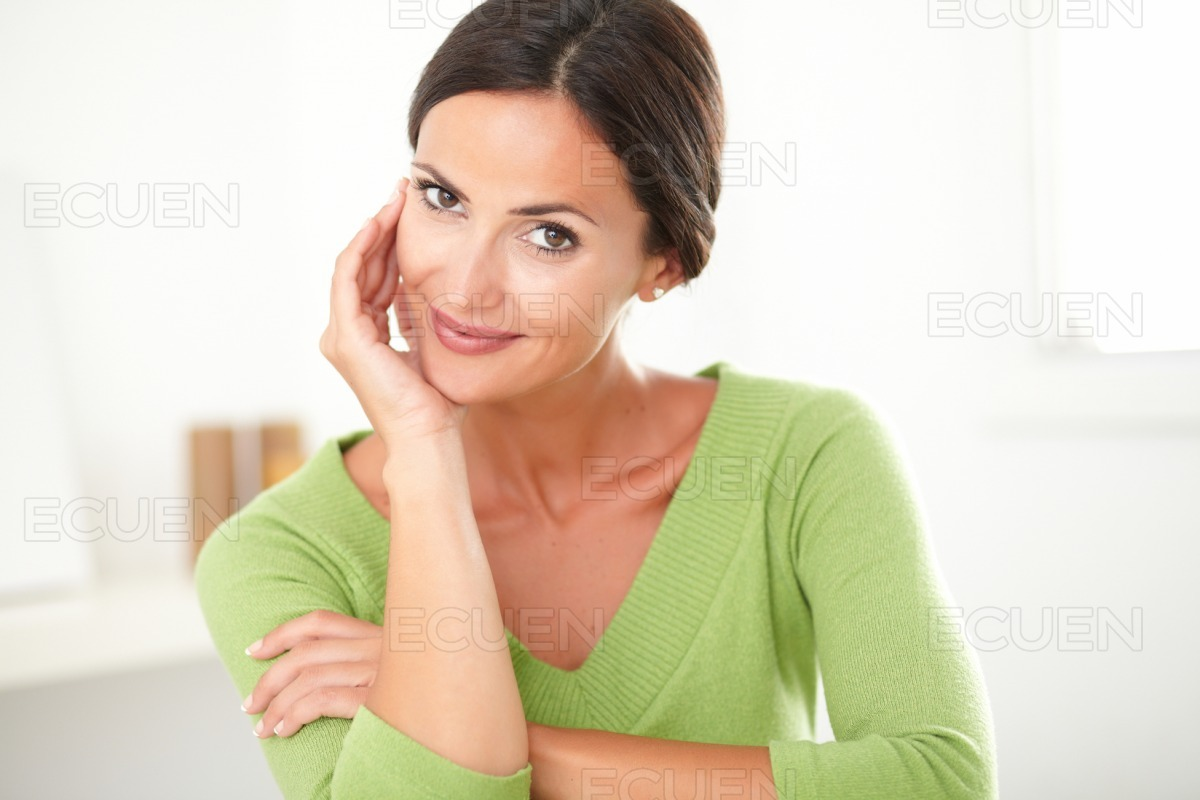 Charming adult woman smiling with satisfaction stock photo