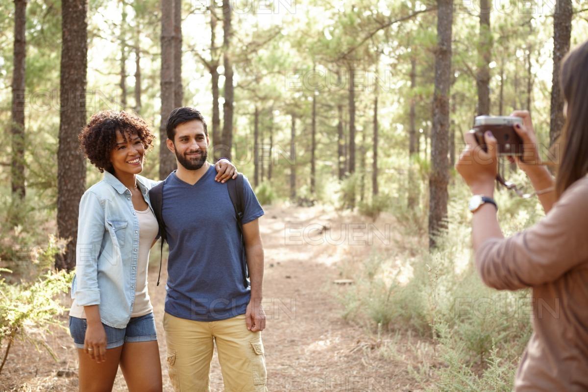 Friends posing for pictures in a forest stock photo