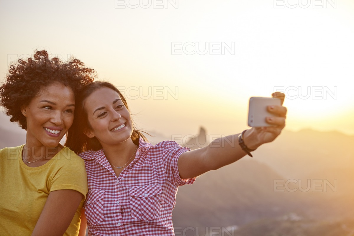 Girl friends taking a selfie smiling stock photo