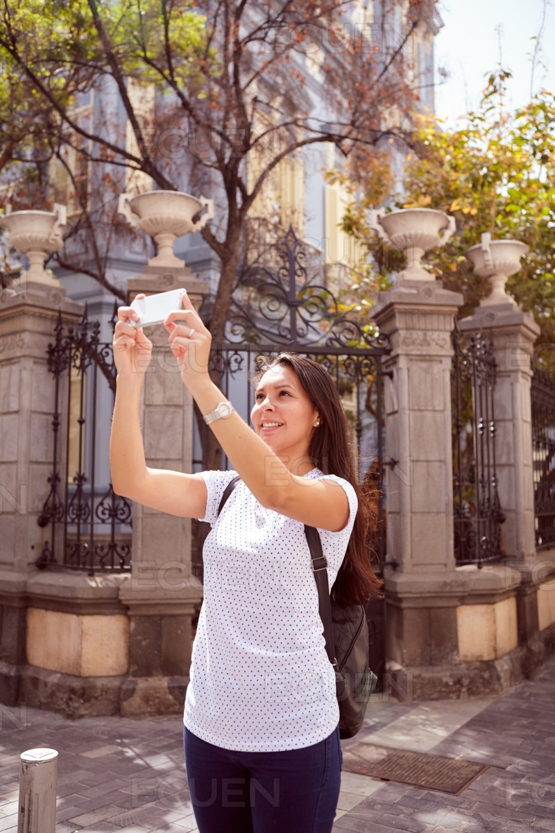 Girl taking a picture above her stock photo
