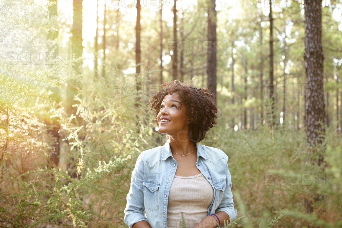 Young girl smiling in the woods stock photo