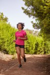 A young girl jogging on a trail