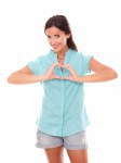 Attractive female making a love sign