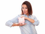 Attractive young lady with her piggybank