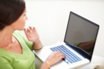 Caucasian woman using a laptop indoors