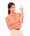 Charming lady in elegant shirt pointing up