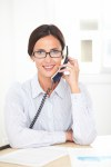 Corporate female employee talking on the phone