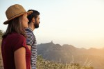 Cute young couple looking over mountains
