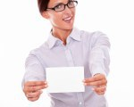 Excited brunette businesswoman with copy space