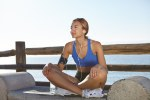 Fitness woman resting on the coastline