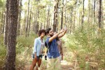 Friends taking pictures of pine trees