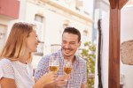 Happily laughing couple drinking some beers