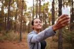 Lovely smiling young girl taking selfie