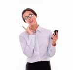 Pensive brunette businesswoman with cell phone