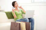 Relaxed lady using a laptop for electronic payment