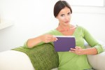 Relaxed woman holding a tablet indoors