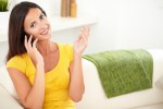 Relaxed woman listening to her mobile phone