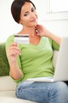 Relaxed woman looking at the credit card