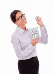 Satisfied and smiling businesswoman holding money