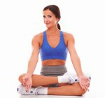 Sporty young woman doing relaxation exercise