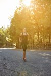 Sporty young woman out jogging alone
