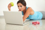 Sporty young woman working on computer