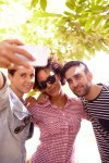 Three friends posing for a selfie