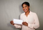 Young african businesswoman showing a letter