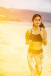 Young brunette jogging on the beach