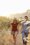 Young couple walking in bright sunlight
