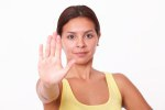 Young hispanic lady with stop gesture